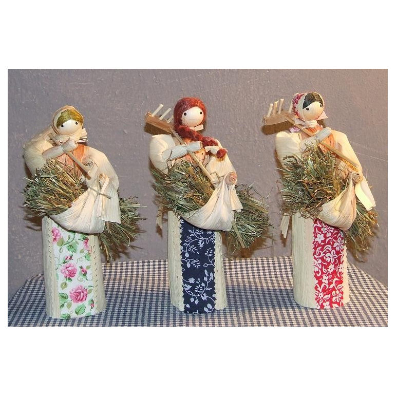 Corn husk doll with straw